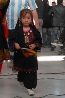 A young Afghan girl participates in the opening ceremony of her new gym