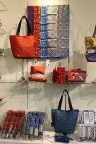 Brightly colored arabesque patterns on umbrellas, scarfs and ladies bags.