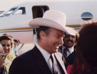 "Mawlana Hazar Imam just after landing in Calgary, Canada,during his Silver Jubilee visit (1983). The City's Mayor, Ralph Klein, ""white hatted"" Imam, making him an Honorary Calgarian."