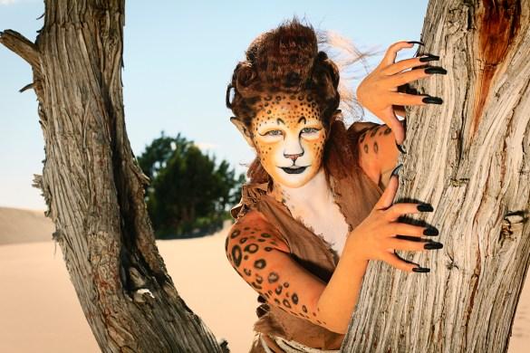 Leopard Woman in a Tree