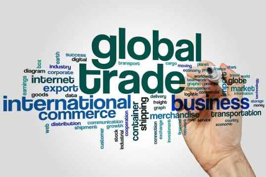Global trade word cloud concept on grey background