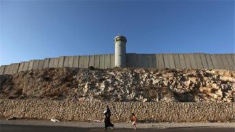 Israel is imposing 'apartheid regime' on Palestinians, UN agency says