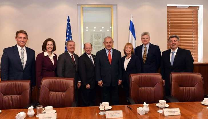 US Senators meeting with Israeli Prime Minister Benjamin Netanyahu, Feb. 22, 2018. Left to right, Jeff Flake (R-Arizona), Catherine Cortez Masto (D-Nevada). Lindsey Graham (R-SC), Chris Coons (D-DE), Maggie Hassan (D-New Hampshire), and Bill Cassidy (R-Louisiana), Cory Gardner (R-Colorado).