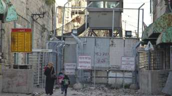 Palestinians in Hebron say Israeli forces strip-searched them on their way home