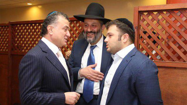 Mikhael Mirilashvili and his son Yitzhakis with Israeli minister Yaffa Deri.