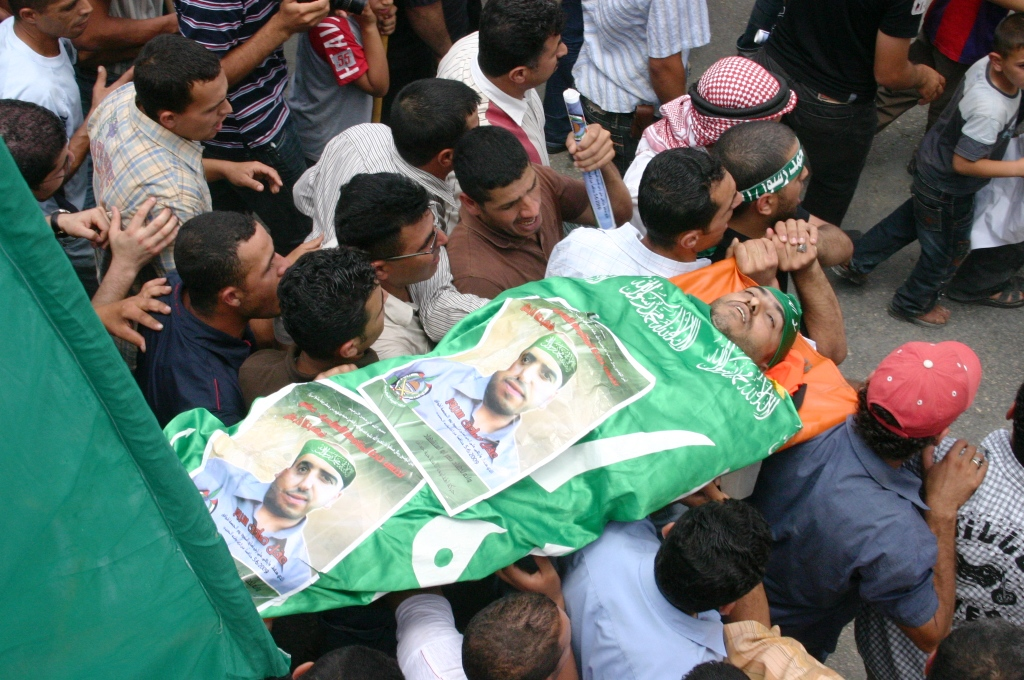 People carrying Aqel Sadeq during his funeral on Saturday