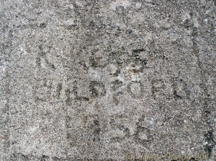 Graffiti as is used to be done. Carved into the granite in 1956.