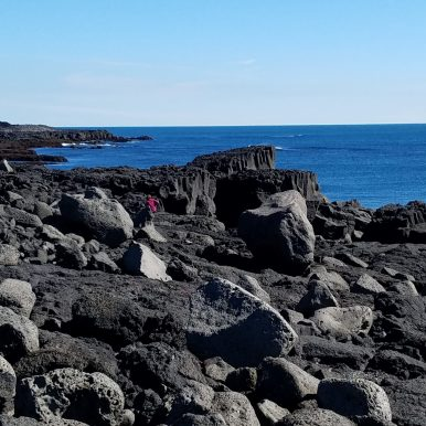 Traversing across lava rock at Brimketill Iceland