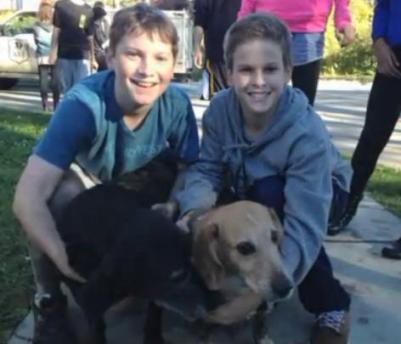 teens save dog stuck in mud