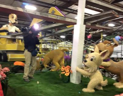 digalert rose parade float with dogs