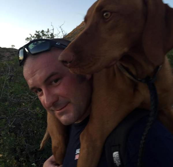 firefighter Tony Stowe carries dog 2 miles