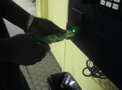Insert Bills Face Up into PHiL Station