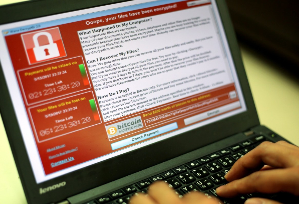 A programmer in Taipei shows a sample of a ransomware attack.