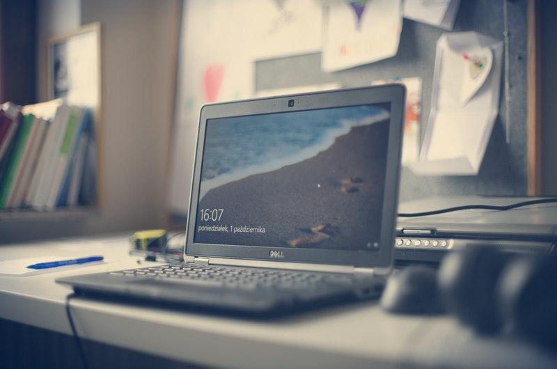 black-dell laptop on white desk-