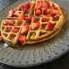 Homemade Waffles topped with strawberries