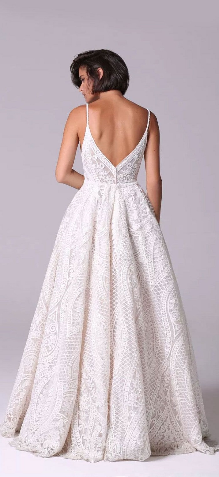 Romantic vintage voluminous dress embellished with crystals and beads that adorn the neckline spaghetti strap crochet lace full skirt wedding dress : Michal Medina #weddingdress #weddingdresses