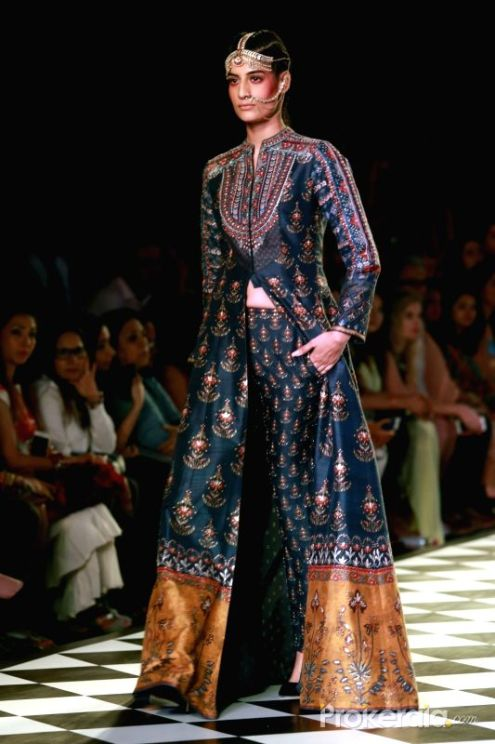 a-model-walks-the-ramp-displaying-an-outfit-by-438289