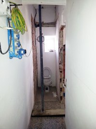 Looking down hallway to toilet room