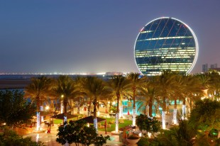 Night illumination in the luxury hotel and circular building