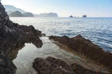 Dark rocks of Adriatic Sea coast. Montenegro