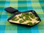 Raclette pan with cheese and spring onion - party food