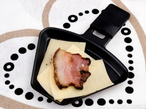 Raclette pan with cheese and bacon