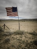 Monument Valley landscape withn an American flag