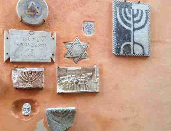 Commemorative plaques on a wall in Rome's Jewish Quarter
