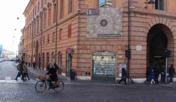 A woman bikes in Ferrara