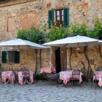 Midst medieval buildings. Pink tablecloths beckon.