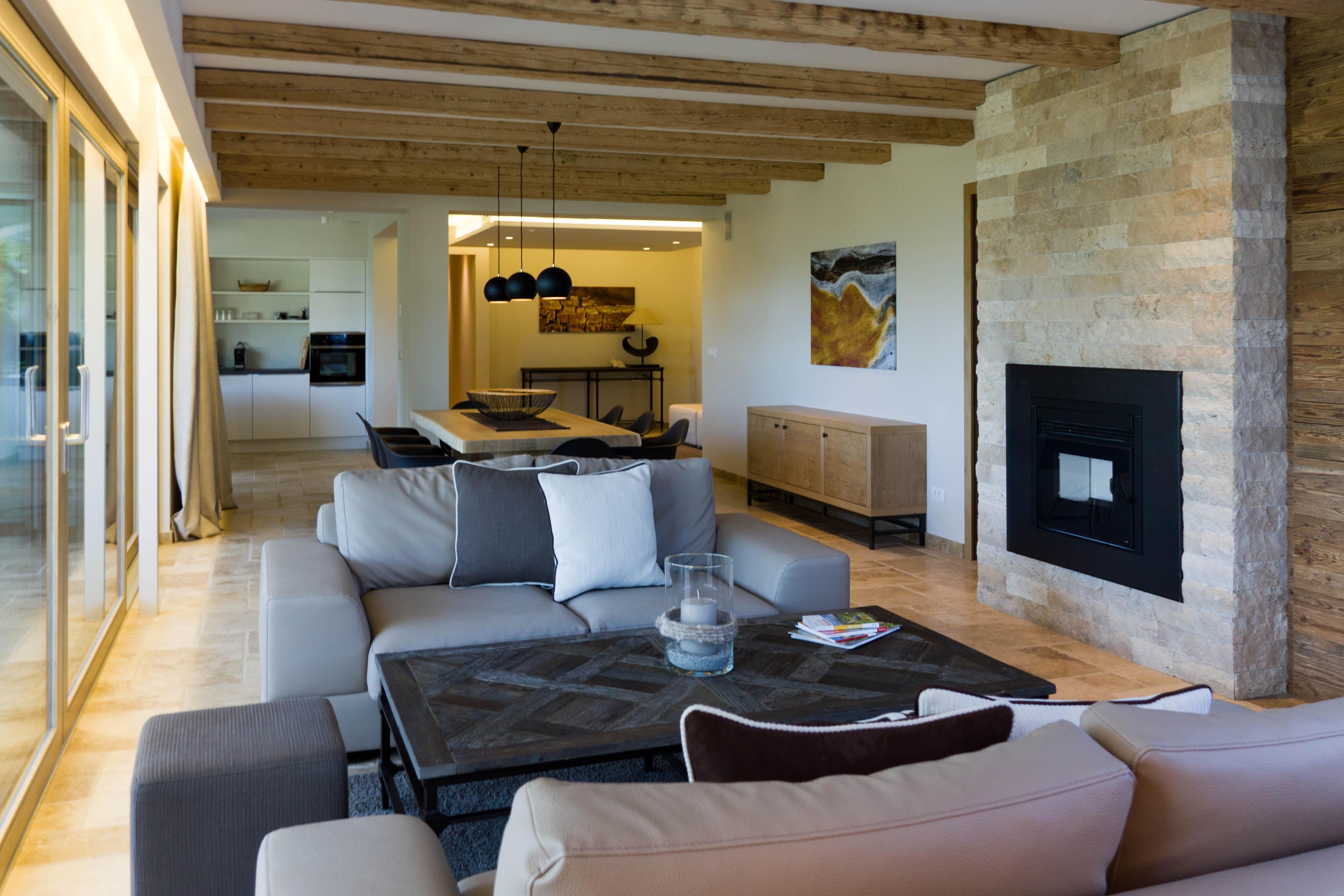 Camino in pietra per soggiorno ambienti realizzati con materiali naturali architettura di