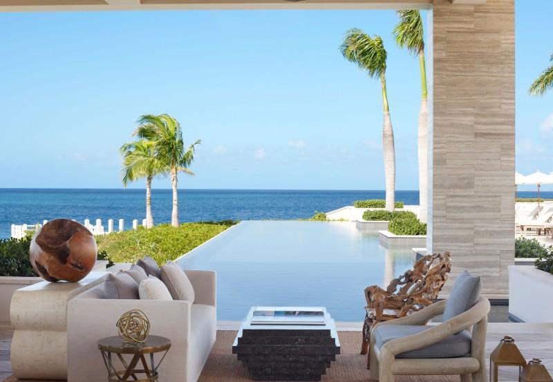 Viceroy-Anguilla-esterno-rivestimenti-in-travertino-zebrato-piscina-sfioro