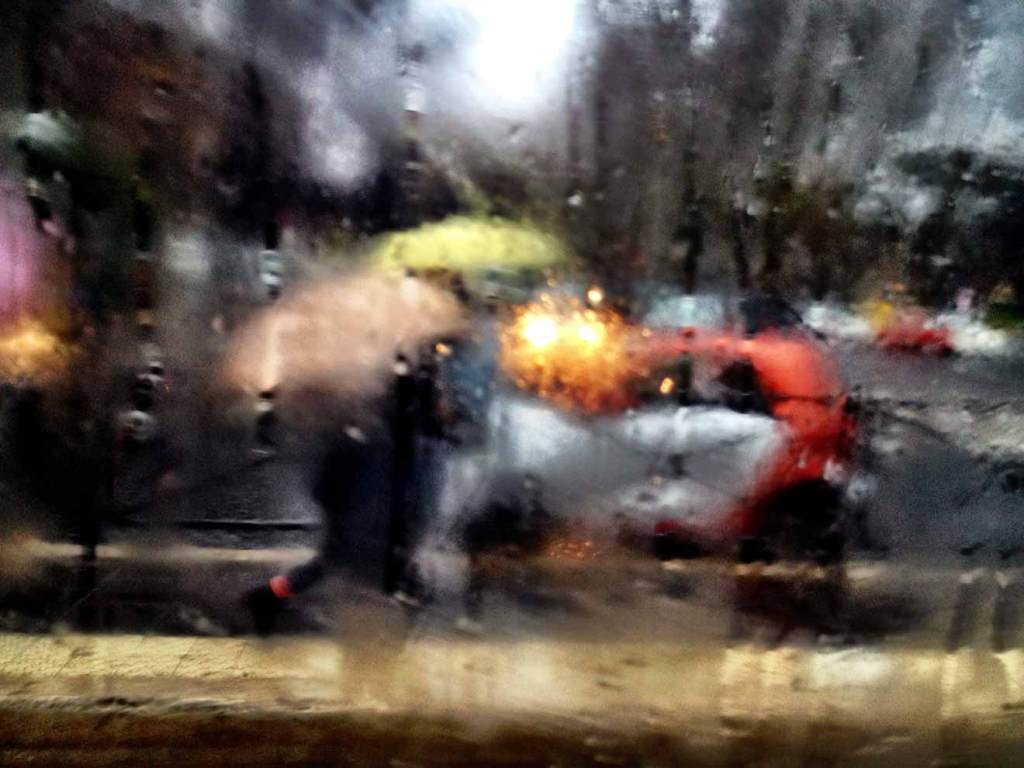 Art and magic is everywhere. A rainy buswindow adds a beautiful filter for the world outside.