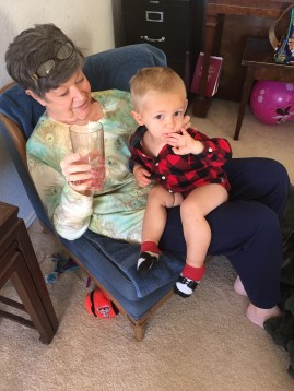 Mimi indulging Levi in some cranberry juice