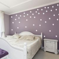 white-polka-dot-wall-decals-with-purple-wall-paint-for-bedroom
