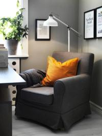 Amusing Black Corner Reading Chair with White Floor Lamp