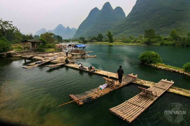 Bamboo rafts on Yulong River with the karst fromations in the background