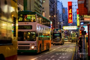 busy street with double decker busses in Hong Kong
