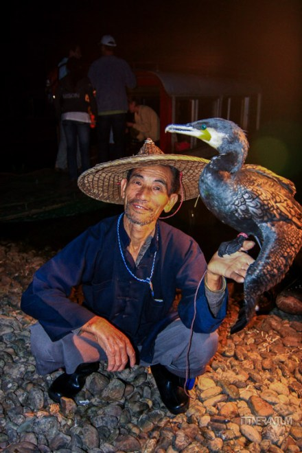 Local fisherman with a cormorant