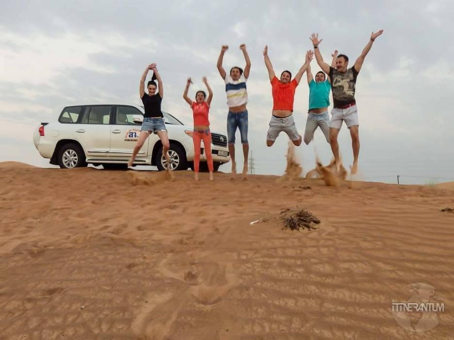 people in the desert, dubai