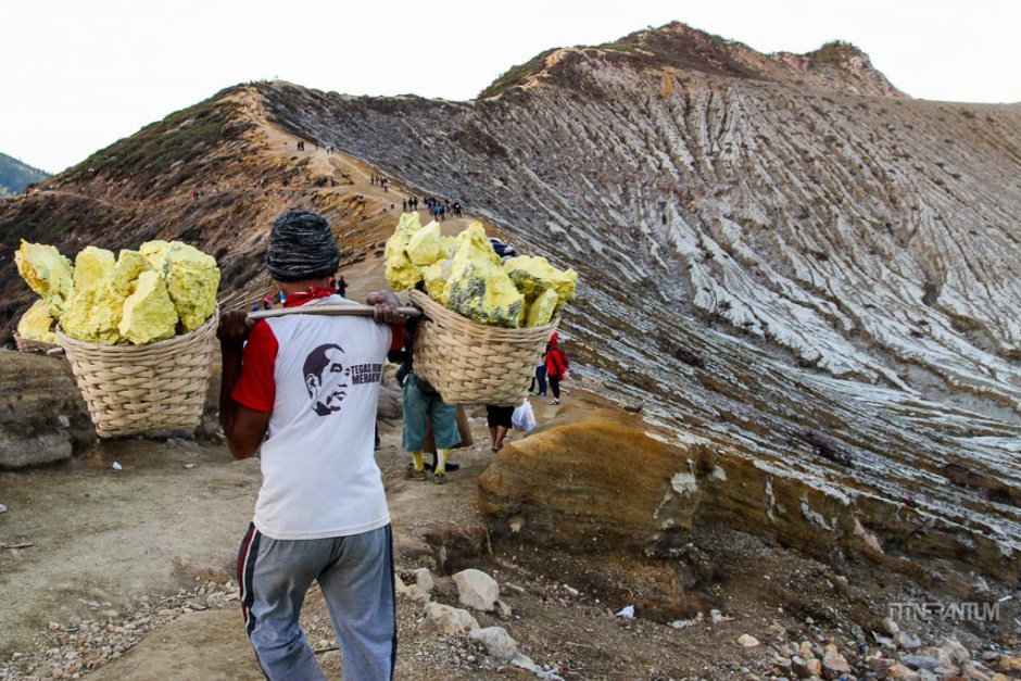 miner carrying the sulfur load at ijen, java