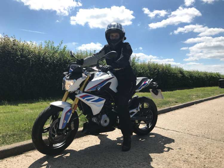 Natalia posing with the BMW G310R wearing her Rev'It gear and AGV Compact Helmet