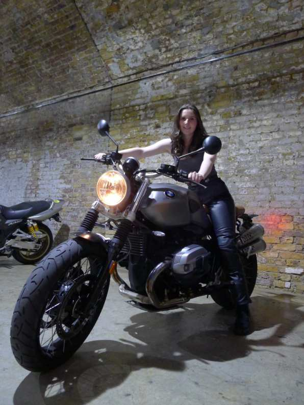Natalia wearing her leather trousers on the BMW R nineT Scrambler