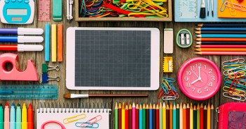 Back to school and technology banner with digital touch screen tablet and colorful stationery