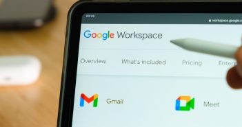 Google Workspace logo shown by apple pencil on the iPad Pro tablet screen. Man using application on the tablet. December 2020, San Francisco, USA