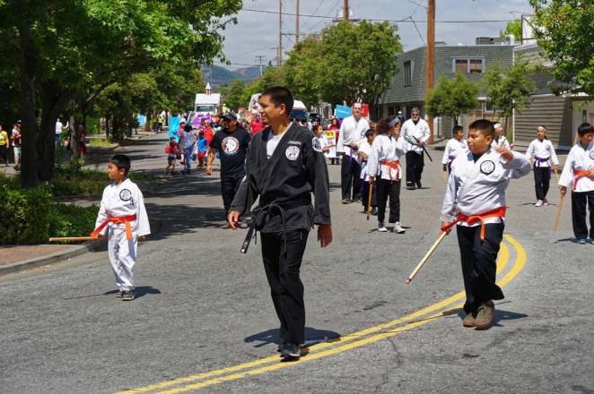 Orange belts walking down the street