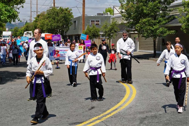 Purple belts walking down the street