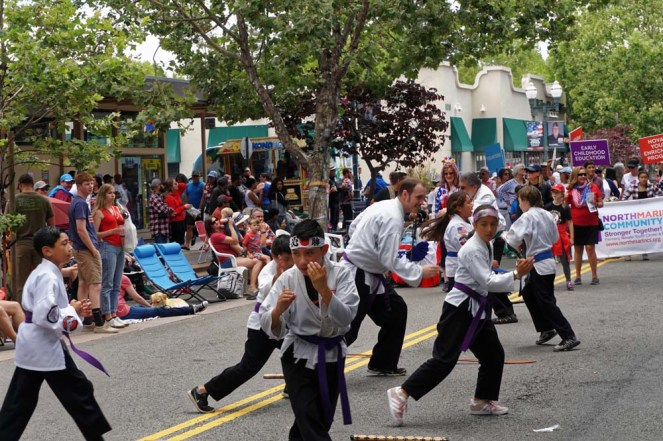 Skill demo by purple belts at parade