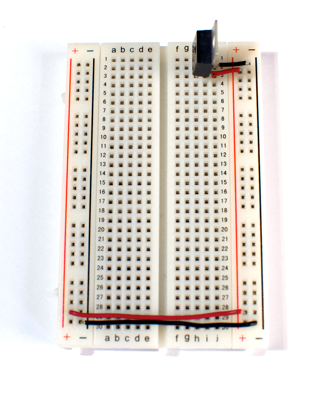 hight resolution of a solderless breadboard with a 7805 5 volt voltage regulator mounted on it there