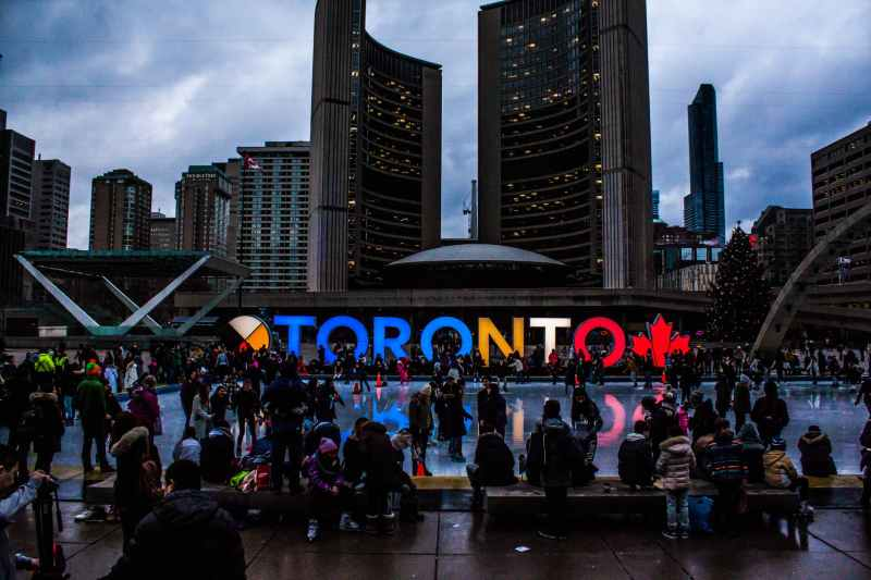 people gathered in front of toronto freestanding signage